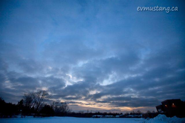 image of sun setting over suburban school yard in winter