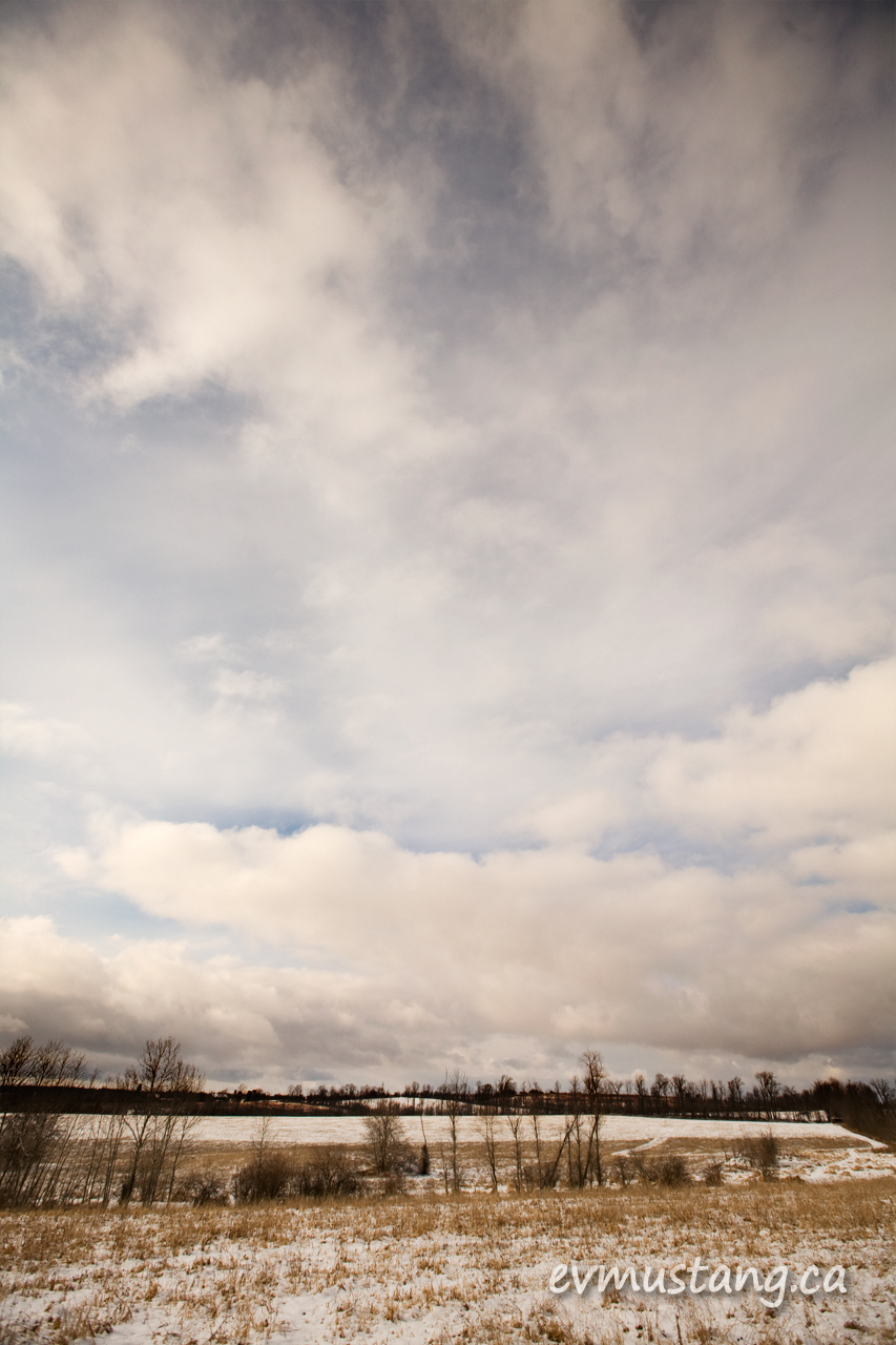 image of field in winter with clouds