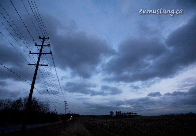 image of spring clouds at twilight with hydro wires