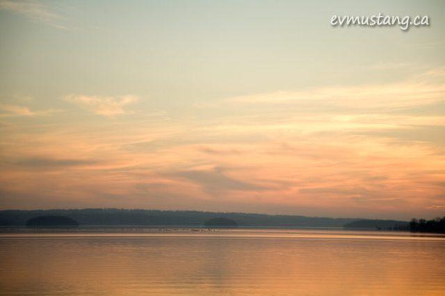 image of orange lake at sunset with mist