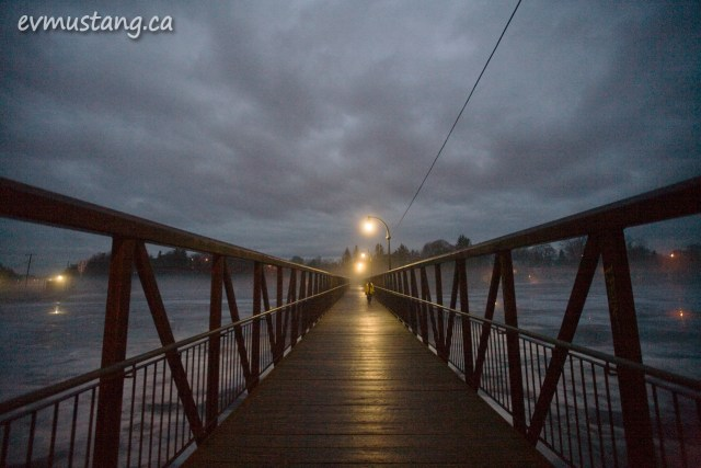 image of london street foot bridge in fog at night