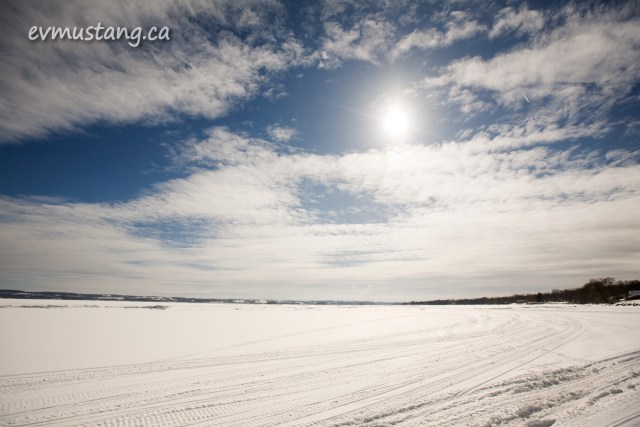 image of snowmobile tracks on frozen lake