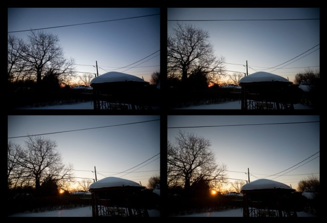 image of sun rising over suburban backyard