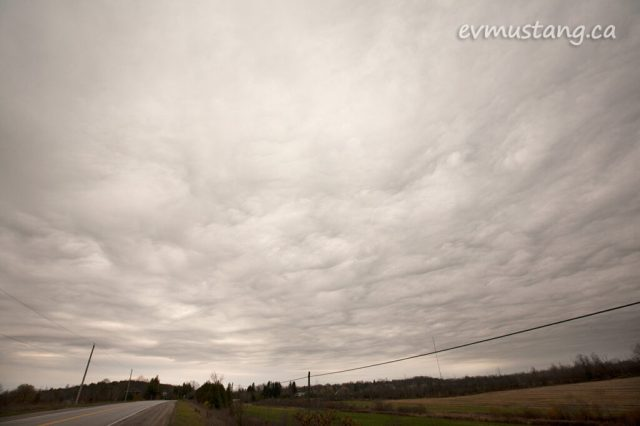 image of grey clouds over rural road