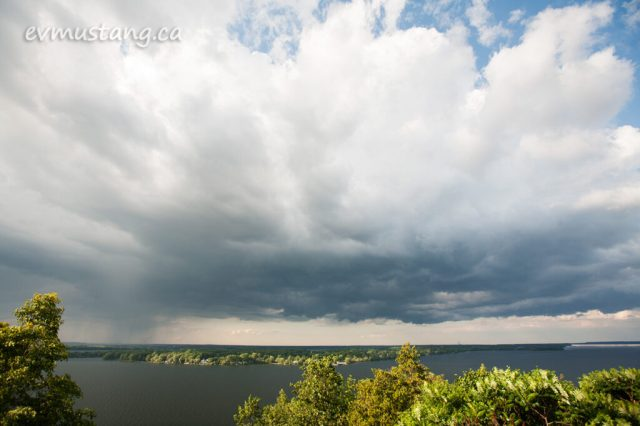 image of rain shower and sun on bay of quinte ontario