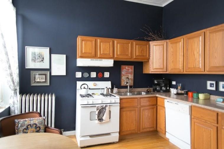 Oak cabinets navy walls