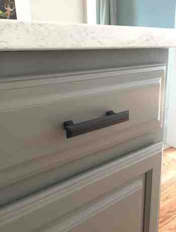 Chelsea Gray Cabinets with Bronze Hardware