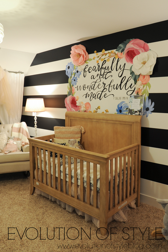 Baby nursery with black and white striped walls