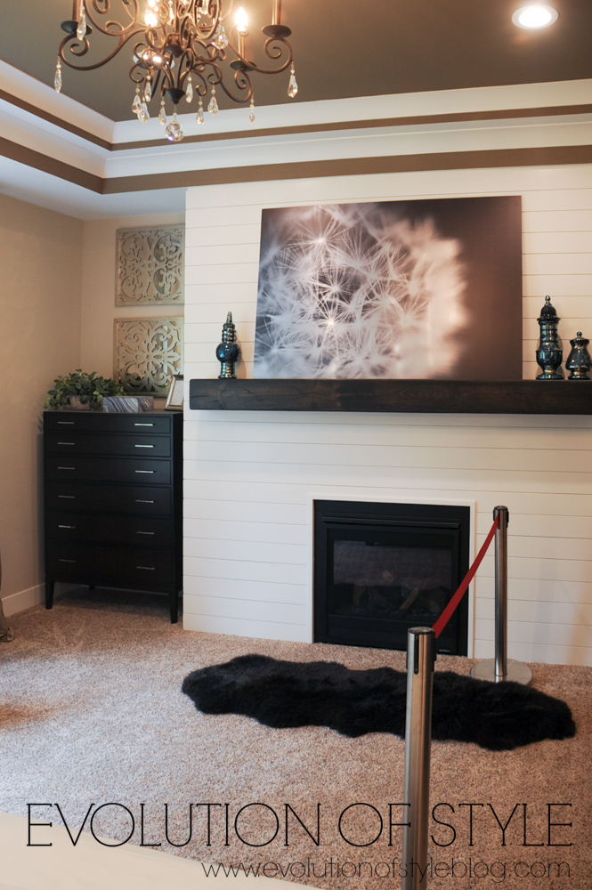 Master bedroom with shiplap fireplace