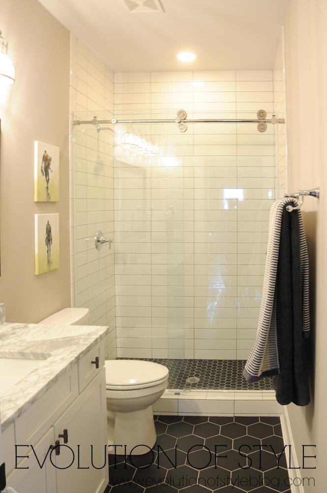 White bathroom with black tile