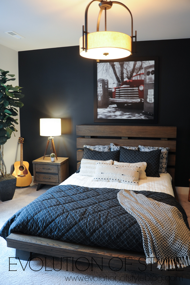 Basement bedroom with dark accent wall