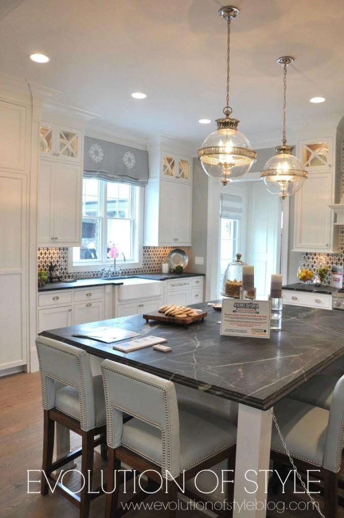 White kitchen with dark countertops