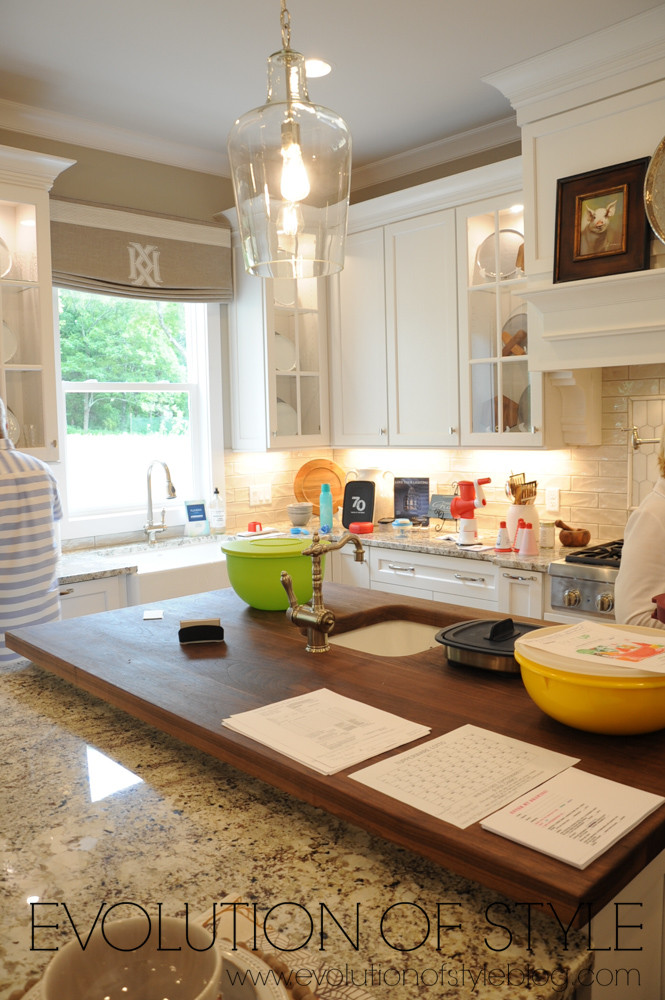 White kitchen with butcher block island