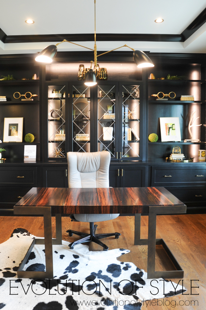 Office with black cabinetry and gold fixtures