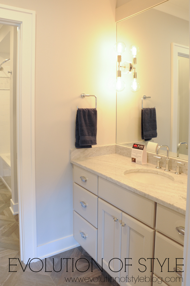 Bathroom with taupe cabinets