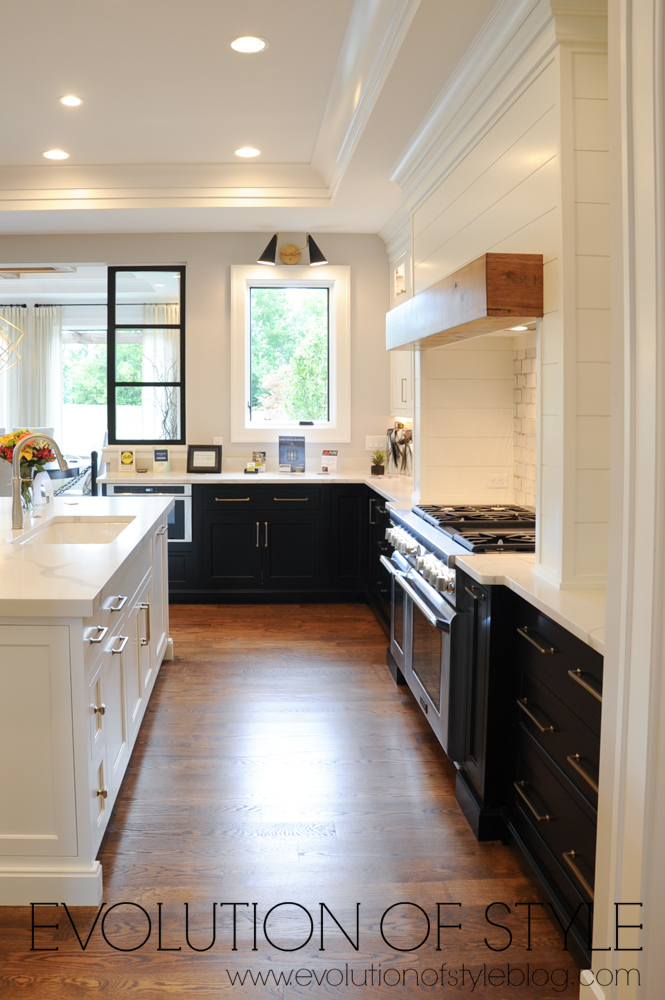 White upper cabinets with black lower cabinets
