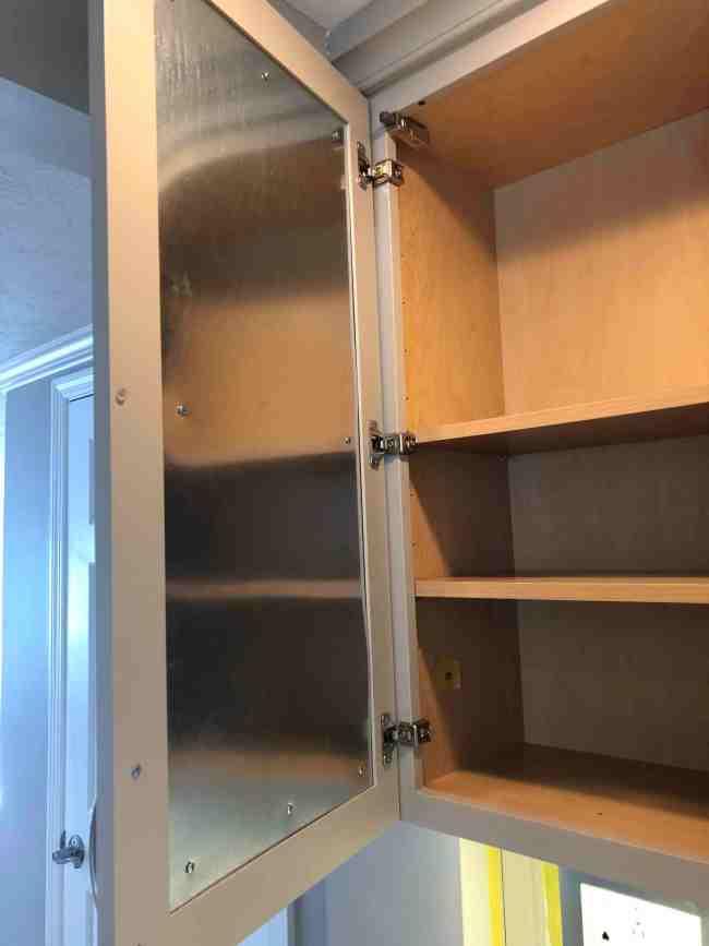 Metal insert on cabinet door