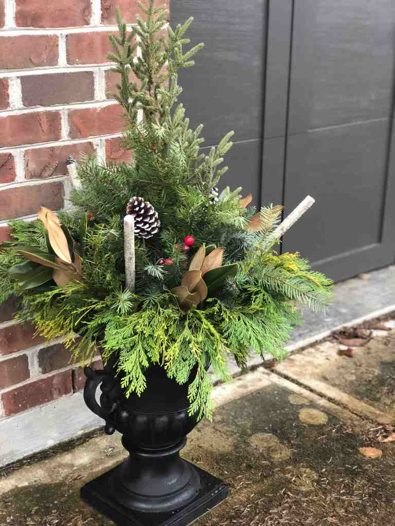 Finished Winter Porch Pots with Evergreen and Magnolia