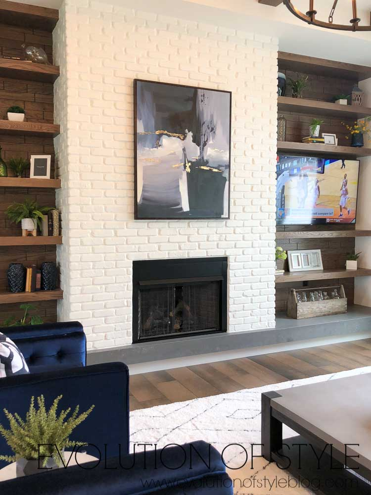 2019 Homearama Day Two - White fireplace with wood bookshelves