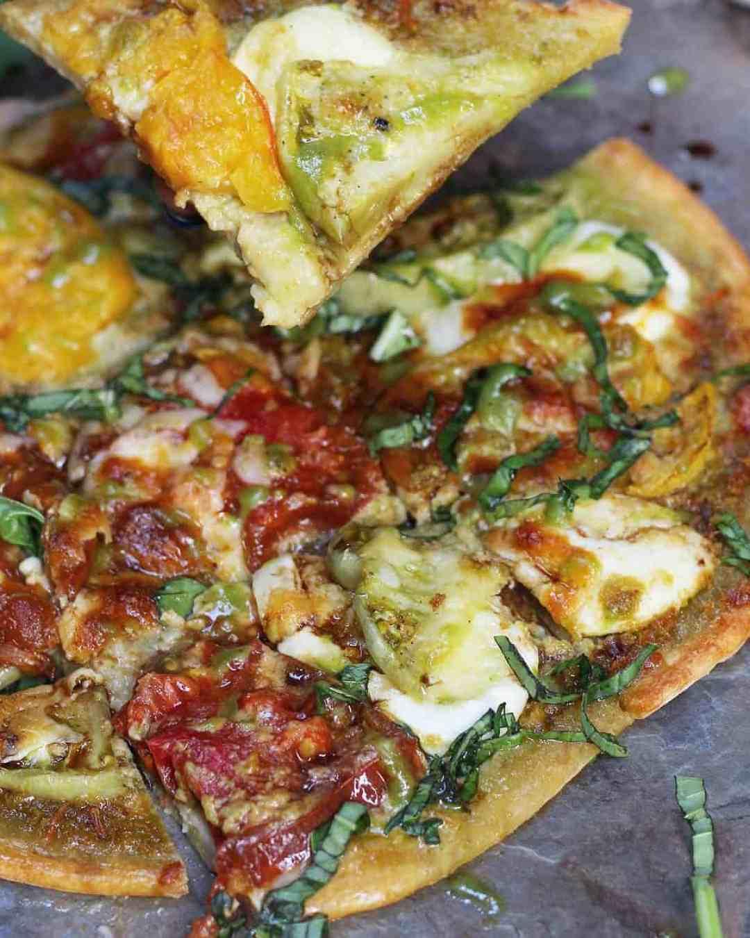 Heirloom Tomato, Mozzarella, and Pesto Flatbread made with Dorot fresh chopped basil and garlic!