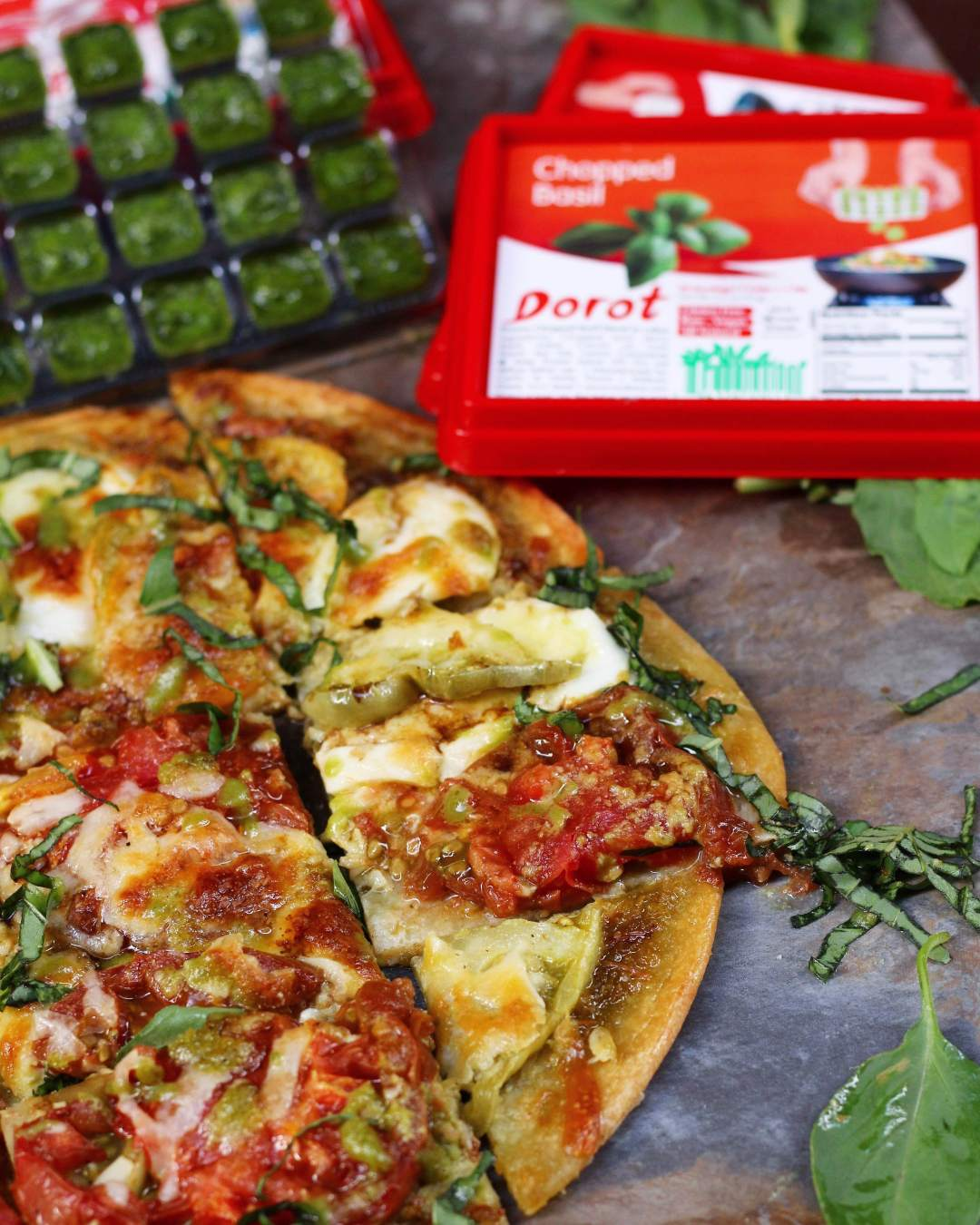 Heirloom Tomato, Mozzarella, and Pesto Flatbread made with Dorot fresh chopped basil and garlic!