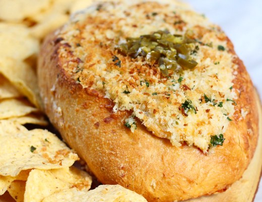 This 3 cheese jalapeno popper dip is here to get the party started! An easy recipe for game day, La Brea Bakery's 3 cheese semolina loaf is turned into a bread bowl stuffed with jalapenos, cheese, and bacon and is sure to be a hit at your next Superbowl Party!