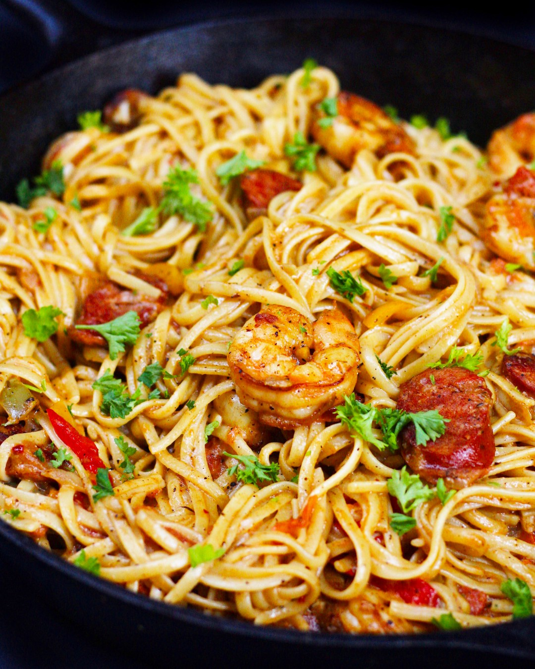 Crazy delicious Cajun flavors in this creamy, decadent Cajun shrimp pasta with sausage and shrimp; perfect for both entertaining and weeknight dinners!