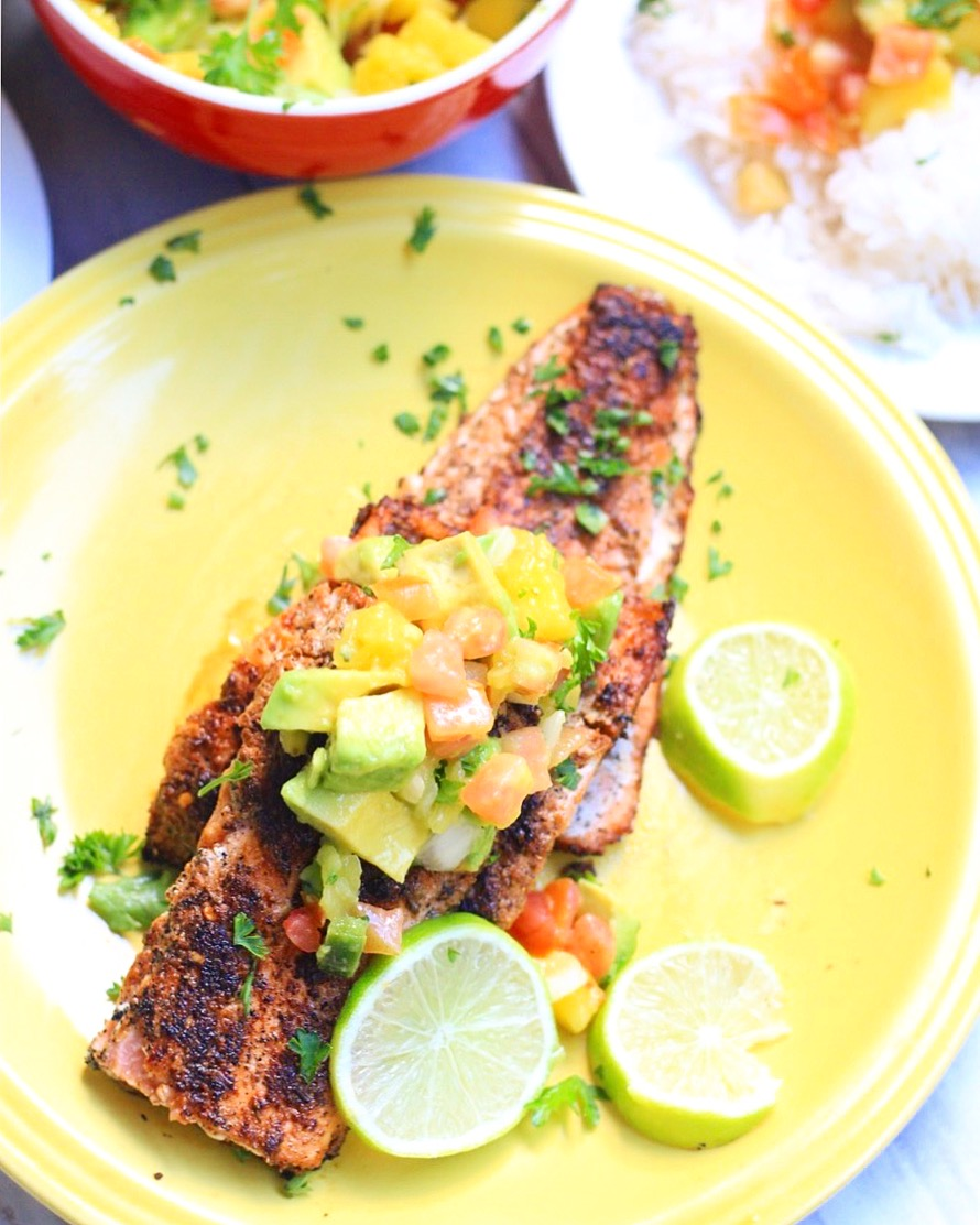 Blackened salmon seasoned with a tasty Cajun spice blend and topped with a bright mango and avocado salsa!