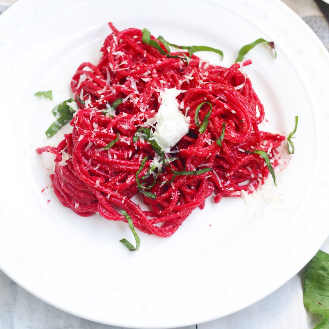 Not only is this beet pesto pasta a beautiful color, but it's absolutely indulging and delicious finished with black truffle goat cheese!