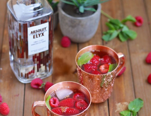 This Raspberry Mule is the perfect fun and festive cocktail to brighten up your holiday season! Made with raspberry cordial, lime, ginger beer, and Absolut Elyx vodka. #ad