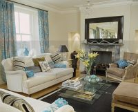 Image: Patterned turquoise curtains and cream sofa in ...