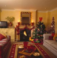 Image: Fairy lights around mirror above fireplace with red