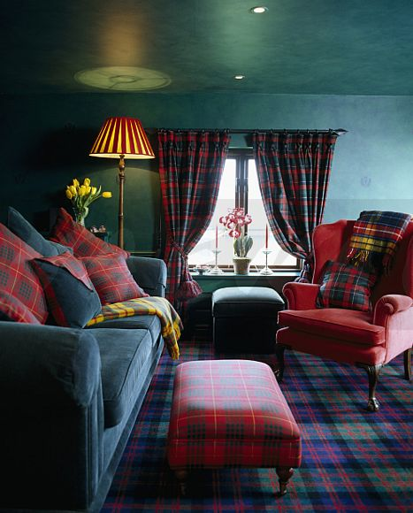Image Tartan cushions on velvet sofa and red armchair in