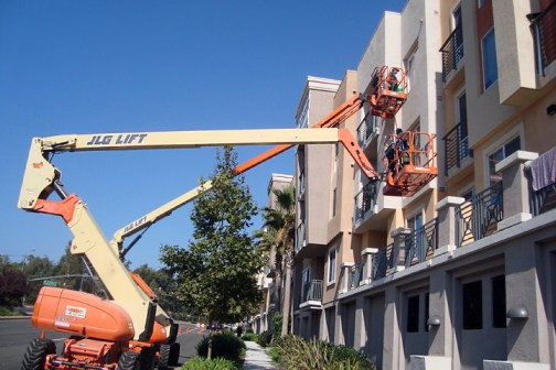 Window washing pro's teams one and two using boom lifts in tandem