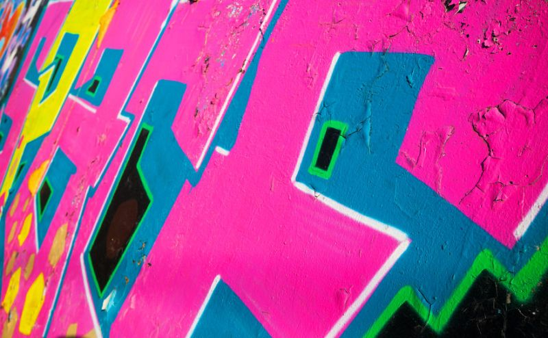38693601 – abstract colorful graffiti fragment over old concrete wall