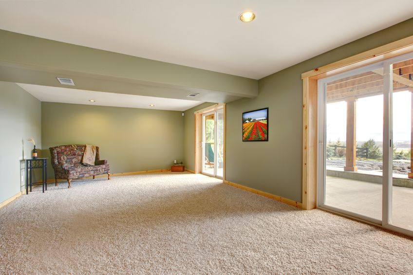 13369374 – ground level basmenet large new living room with green walls.