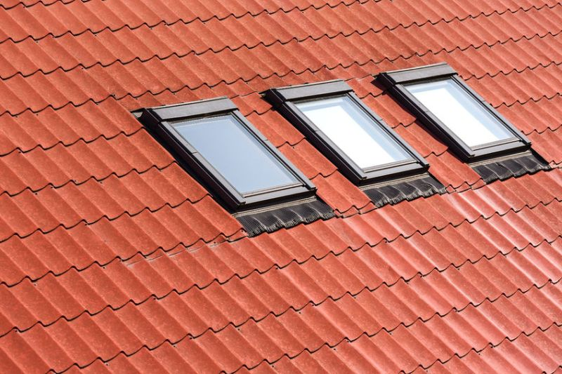 31645120 – modern orange tiled roof with three skylights