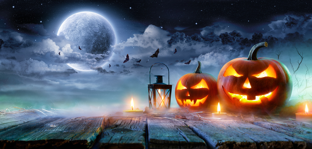 Jack O' Lanterns Glowing At Moonlight In The Spooky Night – Halloween Scene