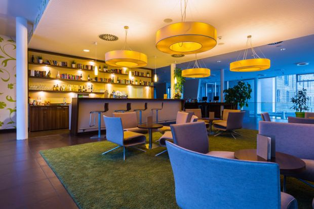 48775692 - hotel bar lounge with big lights an illumination in 50s style