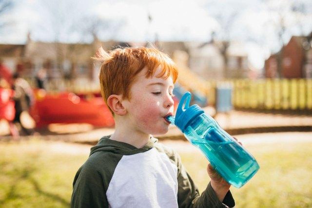 boy-drinking-water-in-park-optimised.jpg