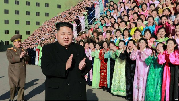 Kim Jong-Un with North Korean soldiers' families