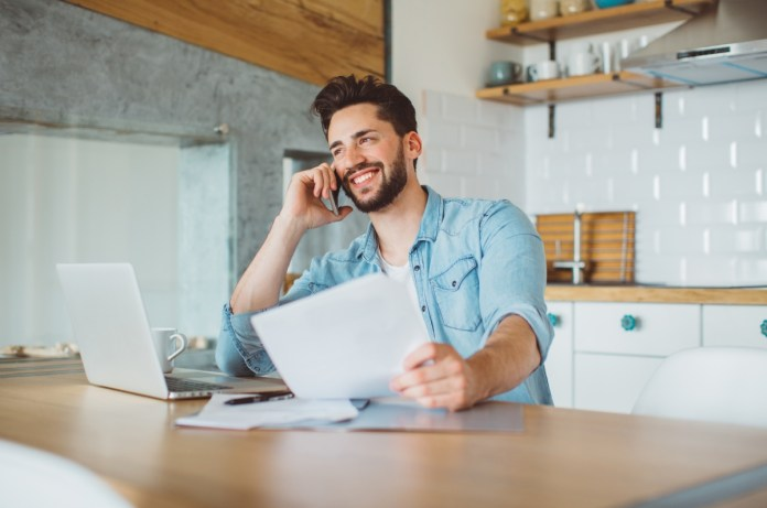 white guy listen to phone while working at kitchen