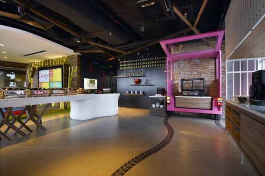 this-deconstructed-pink-minibus-serves-as-the-offices-juice-and-snack-bar