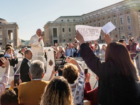 A group of Filipinos, including Marissa Lazaro and Katherine Bautista, mothers of the victims of drug-related killings in Manila, catches the attention of Pope Francis during his general audience at the Vatican on October 9. Photo: UCAN/ Brother Jun Santiago cssr