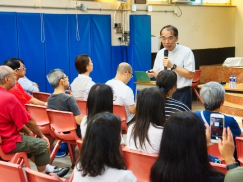 Father Lam during the briefing session on October 19.