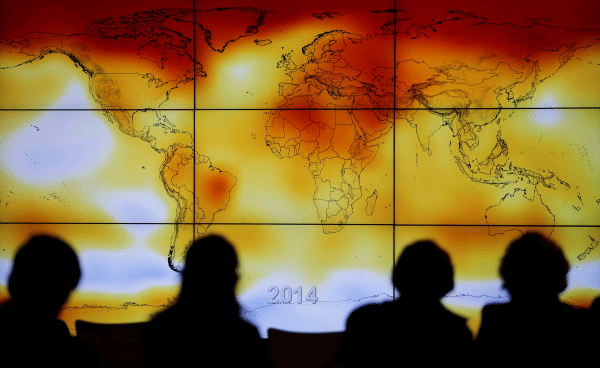 Participants look at a screen showing a world map depicting climate anomalies during the World Climate Change Conference at Le Bourge, France, in December 2015. File photo: CNS/Reuters