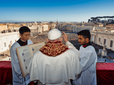 Above: Pope Francis delivers his Christmas urbi et orbi (to the city and the world) blessing from the central balcony of St. Peter's Basilica on December 25. Photo: CNS/Vatican Media
