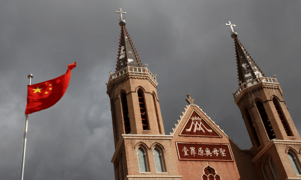 The Chinese national flag flies in front of a Catholic church in the village of Huangtugang, Hebei province, China. File photo: CNS/Reuters