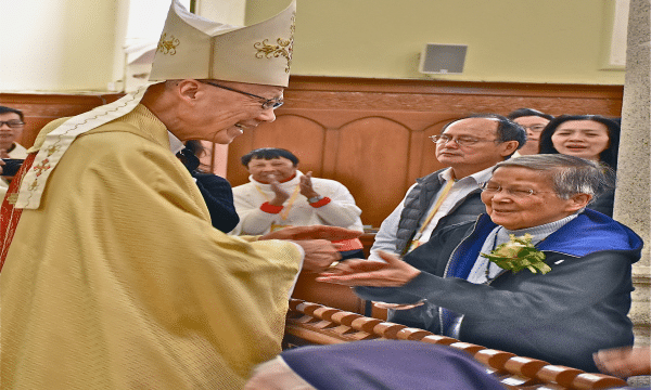 Sister Kam shaking hands with John Cardinal Tong Hon during a Mass for jubilarians at the Cathedral of Immaculate Conception, Caine Road, on December 7.