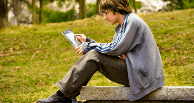 A teenager using an iPad. File photo: CNS/St. Louis Review